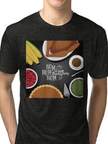 Flat lay Nom nom nom Happy Thanksgiving dinner design Tri-blend T-Shirt