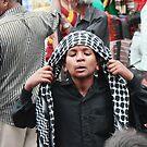 Putting on a Headscarf Charminar by Andrew  Makowiecki