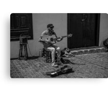 The Busker and his Dogs Canvas Print