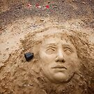 Face in the sand by Ludwig Wagner