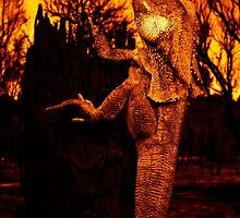 Frilled Neck Lizard on a Log Destroyed by Bushfire by bexish