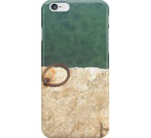 Teal waters and a rusty ring in a dock iPhone Case/Skin