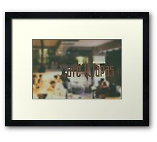 Cafe And Tapas Restaurant Sign With Blurred People Background Framed Print