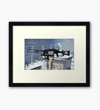 Machine gun on warship Framed Print