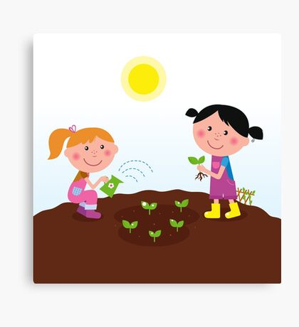 Two happy kids watering and planting plants in the garden Canvas Print