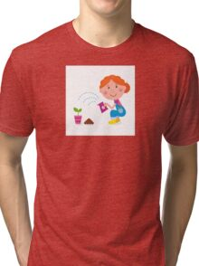 Small girl is watering plant in the garden Tri-blend T-Shirt