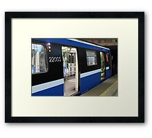 Subway train at the station Framed Print