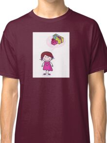 Happy christmas girl in red costume making angel in snow Classic T-Shirt