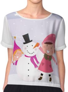 Happy smiling kids in winter costumes making snowman Chiffon Top