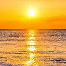 Sunset on the beach by gianliguori