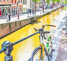 Bicycle and canal in Amsterdam by gianliguori