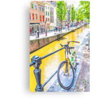 Bicycle and canal in Amsterdam Canvas Print