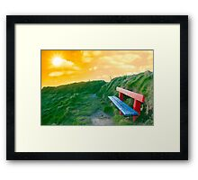 bench on a cliff edge at sunset Framed Print