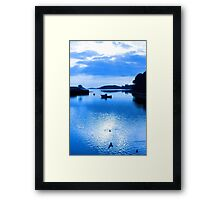 blue toned silhouette of boat and birds at sunset Framed Print
