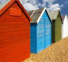 Multi-coloured beach Huts by Dave Hare
