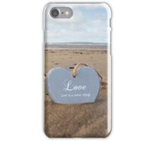 couple of inscribed wooden love hearts in the sand iPhone Case/Skin