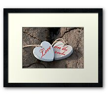 love on the rocks wooden hearts Framed Print