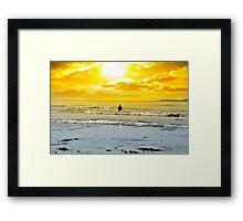 man fishing among the waves Framed Print