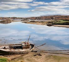 old beached fishing boat on Irish beach by morrbyte