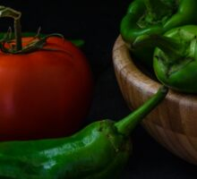 Green peppers and tomato on dark background Sticker