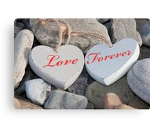 two love hearts on a rocky beach as one Canvas Print