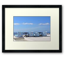 Comfortable seats looking over the caldera in Santorini Framed Print