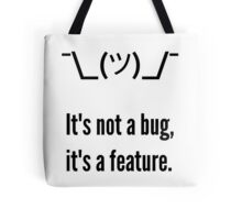 Shrug It's not a bug, it's a feature. Black Text Programmer Excuse Design Tote Bag