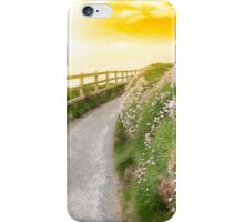 wild flowers along a cliff walk path iPhone Case/Skin