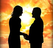 young loving couple holding hands in silhouette by morrbyte