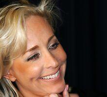 Blond Woman Smiling by Henrik Lehnerer