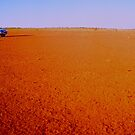 Driving In Outback Australia 20 Kilometres from Uluru by Ronald Rockman