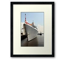 Flags on a warship    Framed Print