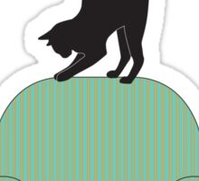 Cat on a turquoise armchair Sticker