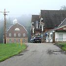 Foggy Morning At The Barns At Polk Center by Geno Rugh