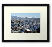Photography of traditional and famous white houses over the Caldera, Aegean sea in Santorini island, Greece. Framed Print