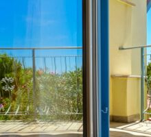 Beautiful view to sea from the inside of apartments. Balcony with marquee. Croatia, sunny day. Sticker