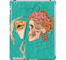 illustration with skull holding a human face mask iPad Case/Skin