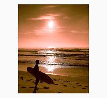 Surfer meets the sunrise over the beach Unisex T-Shirt