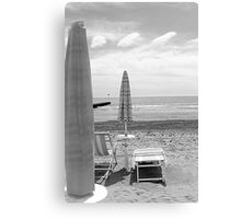 deck chairs on the beach Canvas Print