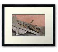 old wooden wheelbarrow Framed Print