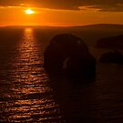 virgin rock sunset on the coastline of ballybunion by morrbyte