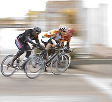 Cyclists Speeding into the Next Curve by Buckwhite