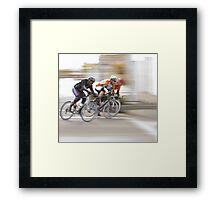 Cyclists Speeding into the Next Curve Framed Print