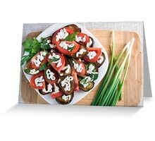 Kitchen table with a dish of stewed eggplant Greeting Card
