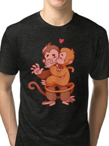 Two cute monkeys kissing.  Tri-blend T-Shirt