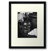 Antique Oil lamp on an old table Framed Print