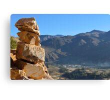 Rocks overlooking hills Canvas Print