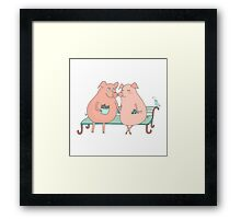 Couple of cute pigs sitting on a bench Framed Print