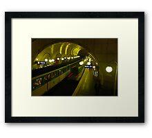 Sur le Metro Framed Print