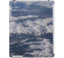 Flying Over the Snow Covered Rocky Mountains iPad Case/Skin